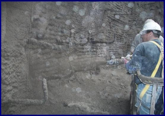 concrete wall placed with shotcrete, a method of concrete placement.