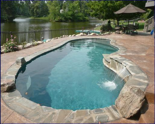 crazy nice pool in shelby michigan. Sun shelf, deepend bench, and pebble finsih.